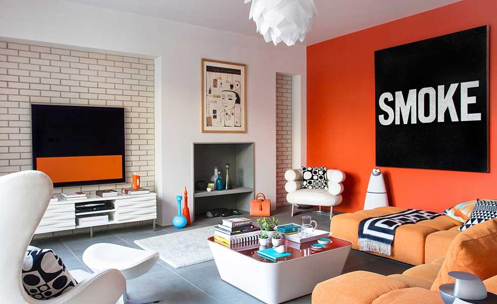 Orange-AMARA-Living-room-with-brick